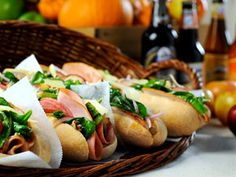 A hearty Octoberfest sandwich of Black Forest ham, honey roasted turkey breast, salami and mayonnaise piled in oversized sub rolls topped with autumn salad with toasted walnuts, sliced red pears and Swiss cheese.