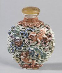Chinese Snuff Bottle ~  Lions among Clouds ~  Qing Dynasty (1644-1911), 1796-1820 ~  Artist/maker unknown  ~    Reticulated porcelain with overglaze enamel decoration  ~  15/16 x 2 5/16 inches (7.5 x 5.9 cm)
