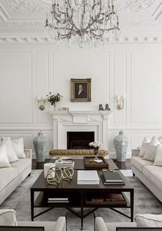 bench seating in front of fireplace- oversized coffee table(s), gold orbs; just love this seating plan