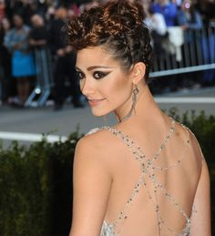 Emmy Rossum Met Gala 2013: tangled crystal back, long crystal earrings, braided updo in fauxhawk shape, winged eyeliner, thin strong eyebrows with little arch