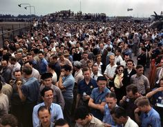 Thousands of North American Aviation employees at Inglewood, California, look skyward as the bomber and fighter planes they helped build perform overhead during a lunch period air show. This plant produces the battle-tested B-25 'Billy Mitchell' bomber, used in General Doolittle's raid on Tokyo, and the P-51 'Mustang' fighter plane, which was first brought into prominence by the British raid on Dieppe, October 1942.