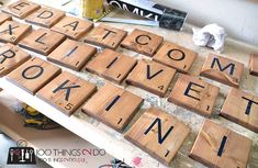 Woodworking Projects How to make Scrabble tiles - Create a warm, welcoming and fun gallery wall including your own Scrabble names. How to make Scrabble tiles as decor. Scrabble Tile Crafts, Scrabble Wall Art, Wood Crafts, Large Scrabble Tiles Diy, Scrabble Letters Printable, Scrabble Family Names, Large Scrabble Letters, Ceramic Tile Crafts, The Journey