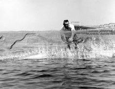 Fishermen throwing out a cast net into the water (1966). | Florida Memory
