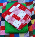 """This easy baby quilt pattern uses the strip quilting method for creating a """"crazy quilt"""" of random patchwork. A great beginners quilt and a perfect stash buster! It is also very quick to make."""