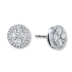 An array of round diamonds twinkle inside a 14K white gold circle in each of these gorgeous earrings for her. The earrings have a total diamond weight of 7/8 carat and secure with friction backs. Diamond Total Carat Weight may range from .83 - .94 carats.