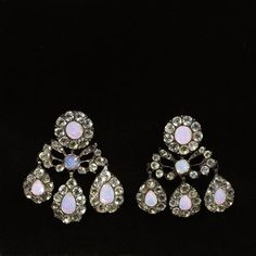 Earrings circa 1760  V& A museum  pink foil beneath a milky blue glass to achieve an imitation of an opal.