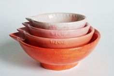 Any baker will appreciate a set of charming, handmade measuring cups. The ombre colours make them a great display piece in a kitchen and each set is hand-painted for a distinctive one-of-a-kind feel. Ombre Nesting Measuring Cup, $45 for set of four, Etsy.com.