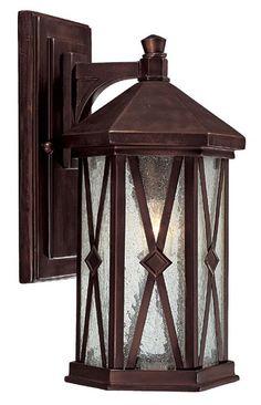 "Saxton Sm. Ext. Wall Light 7""W x 14""H x 8""E Burnished Bronze Finish Seeded Glass Steel/Aluminum 1M/100watt Collection: Saxton $140"