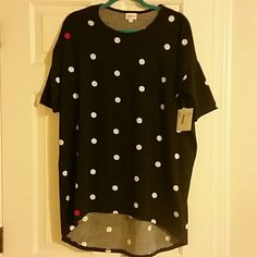 "Lularoe Tunic  ""Irma"" high low Black with white polka dots. This will fit up to size XL. Very soft and comfortable in a high/low style tunic. Great with leggings.  Rare like all Lularoe clothes. Only a small number are made of each print or even solid colors. Irma T shirts run big so this will fit anyone up to a size xl. The only difference in the Irma in sizes is the width across the chest and arms. I normally wear an XL but I like this style in a S or M. Great with leggings or skinny…"