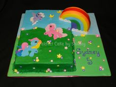 """My Little Pony My Little Pony sheet cake w/3D rainbow. 9x13 sheet cake, iced in buttercream. Ponies are fondant. Rainbow is a 6"""" round..."""