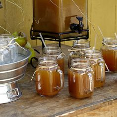 cider!!  Have cinnamon sticks to put in the glass...ribbons in wedding colors...pretty sticker on the side...all set!  Good price on this site, reasonable shipping, too!