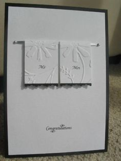Made this for a friend of our son's who is getting married next week.  Words computer generated. Pop dots between towel layers to look more 3D. Strip of silver card for towel rail.