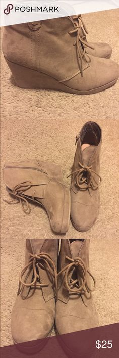 Tan suede wedge booties Tan in color Suede booties.... bought them in 2016 and wore them maybe 5 Times.... in very good condition... selling because I just don't wear them any more. Shoes Wedges