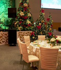 Elegant ruched chairs with gold and white patterned linens ~ #christmas #ideas #party #decor #lovely #eventuresinc