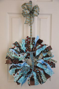 Baby wreath I made for sweet baby Jackson..  His nursery is decorated in brown and blue