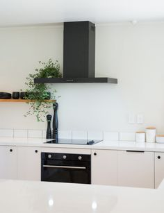 These before and afters prove a lick of white paint can go a long way Photography by: Daniel Allen Old Kitchen, Kitchen On A Budget, Open Plan Kitchen, Kitchen Living, Home Living Room, Kitchen Ideas, Installing Laminate Flooring, Industrial Style Lighting, White Laminate