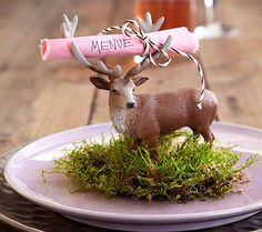 Rather than a table setting imagine a reindeer leaping out of the buckets you have.
