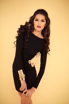Knit black dress with side cutout, gold detail.  www.facebook.com/editacollection2011