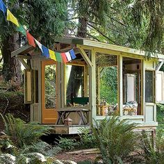 """Airy backyard shelter Dave and Terry Maczuga of Bellingham, Washington, devised a trail system through their landscape that leads to their airy glass-and-wood shelter tucked among conifers.  """"We love to come here with a bottle of wine and sit and enjoy the birds,"""" Dave says.  Read more: 41 gorgeous garden paths   Photo: William P. Wright, Sunset.com"""