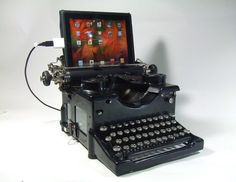 its a typewriter set up to function as a keyboard for an ipad and hold it... among other things