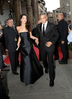Pin for Later: 22 Times George and Amal Clooney Looked Madly in Love  George held Amal's hand on their way into a charity event in Italy in September 2014.
