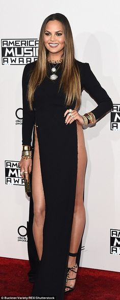 589dc3f6e6ab Gigi Hadid is a vision in white off-the-shoulder gown at 2016 AMAs