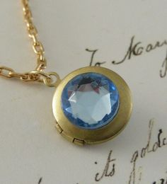 Locket Gold Necklace with Blue Aquamarine Rhinestone Birthstone Pisces Vintage Necklace. $24.00, via Etsy.