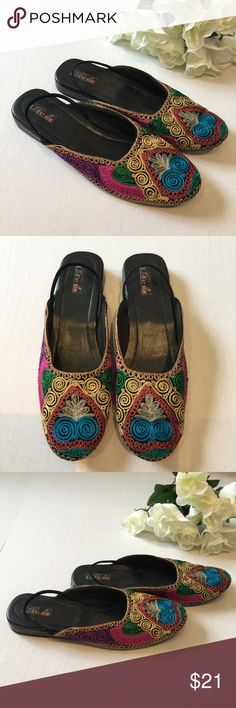"""NWT Indian embroidered slip on shoes 7.5/8 Pretty colorful slip on shoes from India. Delicate embroidery in multicolor swirl patterns, hard sole, slight wedge heel and an elastic heel strap to hold them in place. New stickers on the back of shoes never worn. Approx women's size 7.5/8. Please check your measurements! Approx Measurements sole length 10 ⅜"""", sole width 3 ¼"""" sole height 1"""" Shoes Flats & Loafers"""