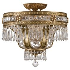 Brimming with elegant appeal, this chic cast brass and crystal chandelier looks great arranged in a pair in your foyer or centered above the dining table.