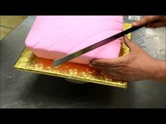Making a Pillow Shaped Cake with a Crown on top. This pillow cake is a perfect birthday cake for a princess theme party made with vanilla cake and bavarian cream covered in pink fondant icing decorated with gold crown on made out of gum paste sprayed with Fondant Crown, Crown Cake, Fondant Icing, Fondant Cakes, Cake Decorating Tutorials, Cookie Decorating, Cake Tutorial, Piping Tutorial, Pillow Cakes