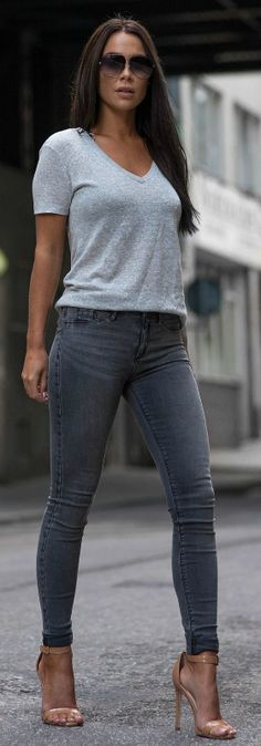 Johanna Olsson is wearing a grey v-neck over a darker paired of grey skinnies.  Jeans: River Island, Top: River Island, Shoes: La Strada