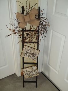"""Welcome Friends"" Tobacco Stick Ladder.  Easy DIY project I bet!  I need something like this to display my wreaths since I have full glass doors :("