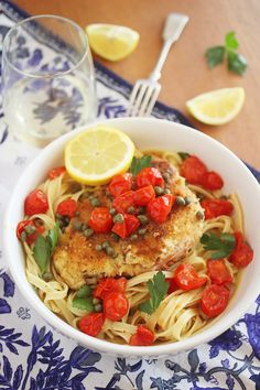 The light, lemony butter-wine sauce and tomatoes make this chicken scallopini easy but elegant, and irresistibly good! | thecomfortofcooking.com