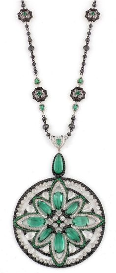 Carnet Jewellery: Designed as an openwork annular pendant, centuring on a radiating motif composed of pear-shaped emerald cabochons within borders of rose-cut diamonds and emeralds, accented with pear-shaped rose-cut diamonds, the outer border of facetted diamond rondelles within a contour of circular-cut black diamonds, to a similarly-set cabochon-emerald surmount, suspended from a long chain of facetted black diamond beads, mounted in white gold, pendant and chain signed Carnet, 2014.