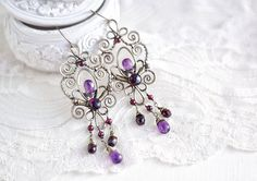 Brass wire wrapped earrings with amethyst and garnet  by SabiKrabi, $65.00
