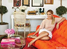 "Inside Lauren Conrad's Beverly Hills Penthouse | InStyle.com THE OFFICE Stacks of fashion books are a mainstay in Lauren Conrad's home office. The rug is made from recycled silk saris; the couch is upholstered in a complementary punchy shade. ""I always gravitate toward feminine details,"" said Conrad. ""On a garment it's a bow; on a sofa it's tufting."""