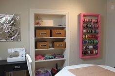 Love this crafty way to organize ribbon and built in shelf.