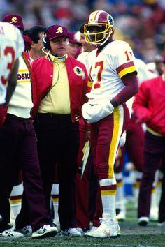 Head Coach Joe Gibbs and Doug Williams of the Washington Redskins https://www.fanprint.com/licenses/washington-redskins?ref=5750