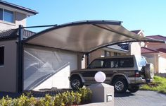 Keep your car and occupants protected from the weather while in the driveway with carport shade solutions.