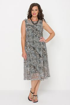 5734 Feline Gored Dress - Elegant and stylish 'Feline' textured dress. Wear with matching bolero or drape jacket 5403. Contents: poly/spandex. Comes with undergarment.