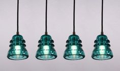 Old telephone pole insulators repurposed for lights! Super cute love it