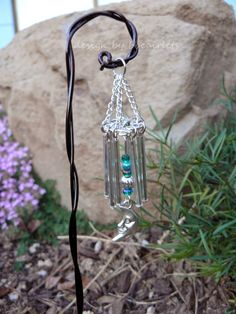 You Better Bling It, Baby: DIY Fairy Garden Wind Chimes - instructions for making this is at their website