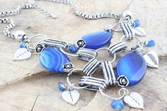 61280 Blue glass and metal necklace incl tax Bib-style chunky blue glass and metal heart necklace. Set on a box chain with extension. A real statement piece! Metal Necklaces, Box Chain, Kissing, Personalized Items, Gate, Bracelets, Necklace Set, Heart, Accessories