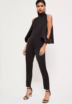 f4bd45327ba channel your inner vixen wearing this all black jumpsuit - featuring a high  neck and open