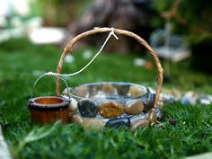 Use an old mason jar to create a wishing well for your miniature garden! via The Magic Onions