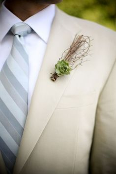Love the light colored suit and the boutonniere.