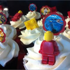NinjaGo themed cupcakes. Made cupcake toppers and also candy melt bricks and Lego guys.