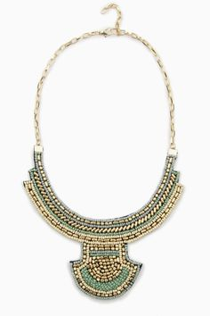 ♥♥ ShopSosie Style : Floriana Necklace.  Ivory, mint, and blue beads mingle with metallic beads on this tribal-inspired bib necklace.