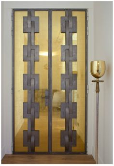great inspiration.... my version would be without all the center embellishments. clean lines.... simple brass doors. Lovely. Pierre Yovanovitch