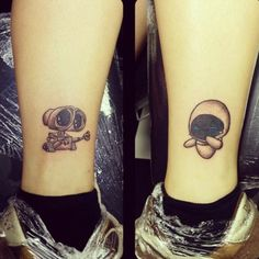 "Little ankle tattoos of WALL·E and EVA, the characters of the Disney film ""WALL·E"" by tattoo artist Morifetus."
